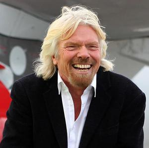 Sir Richard Branson says he lives on his holiday island in the British Virgin Islands because he loves it, adding he has not left Britain for tax reasons