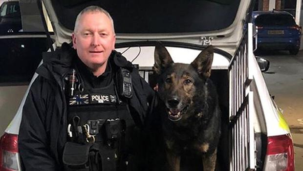 Odin with handler Pc Carl Woodall (West Midlands Police/PA)