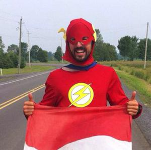 Jamie McDonald, 27, has completed a 12 month gruelling charity run across Canada dressed as a superhero.
