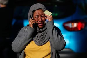 Grief-stricken people at the scene
