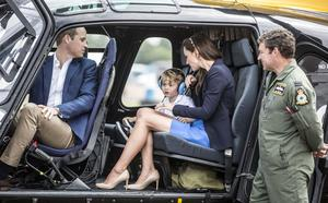 Prince George sits in a Squirrel helicopter with his parents the Duke and Duchess of Cambridge during a visit to the Royal International Air Tattoo at RAF Fairford – the world's largest military airshow (Richard Pohle/The Times/PA)