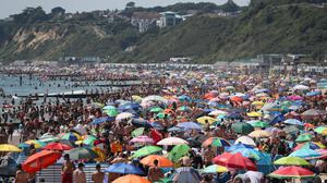 Crowds on the beach in Bournemouth (Andrew Matthews/PA)