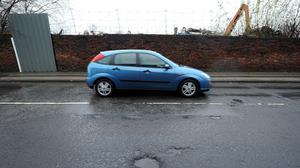 A fund to fill potholes has been branded a gimmick (Martin Rickett/PA)