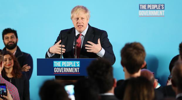 Prime Minister Boris Johnson at a rally with party supporters (Gareth Fuller/PA)