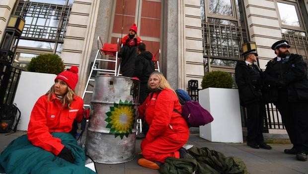 Activists outside BP's headquarters in St James' Square, London (Victoria Jones/PA)