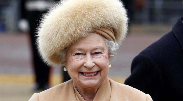 The Queen wearing a fur hat during the unveiling of a statue of the Queen Mother in London in 2009 (Kirsty Wigglesworth/PA)