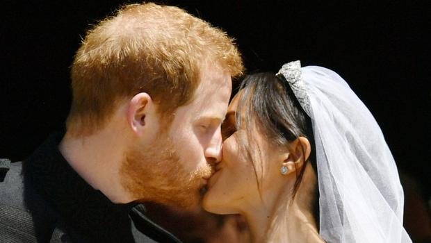 Prince Harry and Meghan Markle kiss on the steps of St George's Chapel in Windsor Castle after their wedding (Ben Birchall/PA)