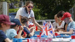 Children and staff at Breadsall Primary School in Derby during a VE Day lunch party to mark the 75th anniversary of the end of the Second World War in Europe (Danny Lawson/PA)