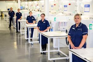 NHS workers in the new facility (Simon Dewhurst/NHS England/PA)