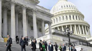Traders are hoping that the US Senate will reach a deal to pump trillions into the economy (Susan Walsh/AP)