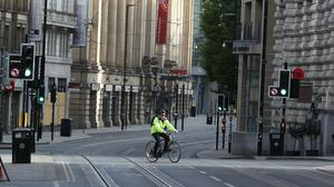 A cyclist on the way to work in Manchester during lockdown (Peter Byrne/PA)