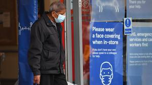 A shopper wearing a face mask leaves Tesco in Leicester city centre as non-essential shops in the city reopen following a local lockdown and face coverings become mandatory in shops and supermarkets in England. (Jacob King/PA)