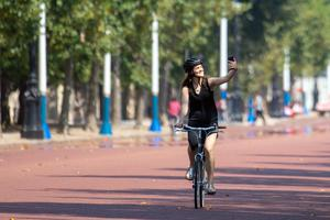 A cyclist takes a selfie on the Mall in central London on August 9 (Dominic Lipinski/PA)
