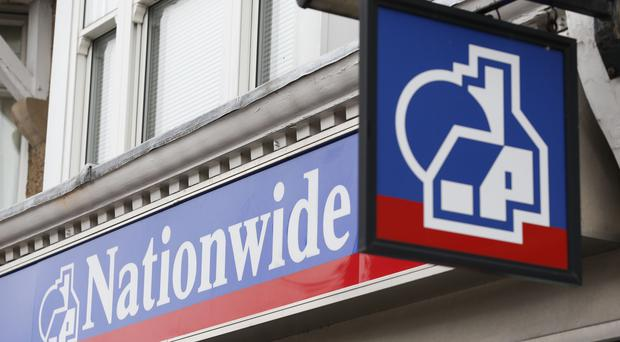 Nationwide has seen annual profits tumble by almost a fifth after taking a £227 million hit on its technology assets and ramping up spending on IT (PA)