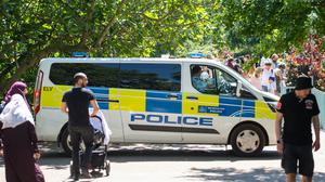 A police patrol in St James Park, as people enjoy the good weather in London, as the public are being reminded to practice social distancing following the relaxation of lockdown restrictions (Dominic Lipinski/PA)