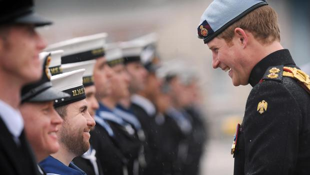 Harry, in his role as Commodore-In-Chief, Small Ships and Diving, presents medals at Portsmouth Naval Base, Hampshire in 2011 (Stefan Rousseau/PA)