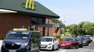 Cars queue at a reopened McDonald's drive-thru (Brian Lawless/PA)