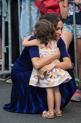 The Duchess of Sussex hugged a young girl during a walkabout in Rotorua (Dominic Lipinski/PA)
