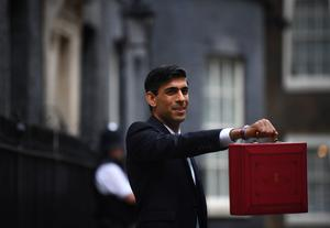 Chancellor Rishi Sunak outside 11 Downing Street before heading to the Commons to deliver his Budget (Victoria Jones/PA)