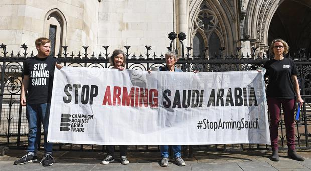 Protesters outside the Royal Courts of Justice, London (Stefan Rousseau/PA)