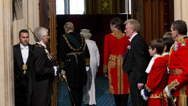 The Queen and the Duke of Edinburgh walk through to the Robing Room, after using a lift, rather than stairs, at the State Opening of Parliament (Yui Mok/PA)