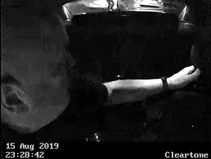 Screengrab taken from video showing Cole moments before he jumps through the window of the Seat, pursued by Pc Harper on foot (Thames Valley Police/PA)