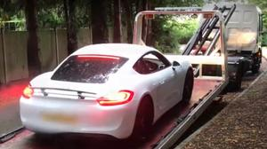 A Porsche being seized as part of the probe (ERSOU/PA)
