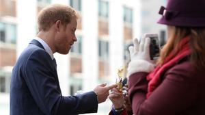 Prince Harry receives a bag of Haribo sweets from a member of the public as he arrives to open Nottingham's new Central Police Station