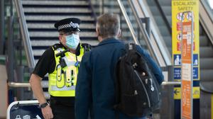 An officer checks that a passenger is travelling for essential purposes (Andrew Matthews/PA)