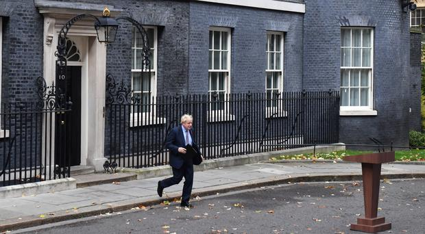 Prime Minister Boris Johnson approaches the lectern to speak in Downing Street (Dominic Lipinski/PA)