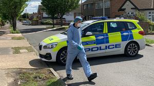 A police forensic officer at the scene in Kerry Drive, Upminster (Tom Pilgrim/PA)