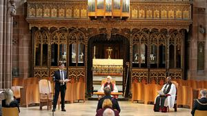 Mayor of Greater Manchester Andy Burnham, left, speaks at a memorial service at Manchester Cathedral (Martin Rickett/PA)