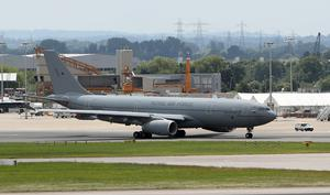 The plane was previously a military grey colour (Steve Parsons/PA)