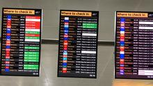 Departure boards showing cancelled Flybe flights (Lucinda Cameron/PA)