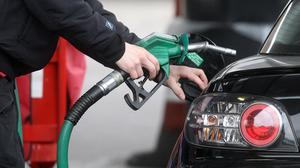 Petrol prices are largely made up by tax and duty (Lewis Whyld/PA)