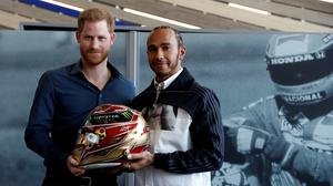 The Duke of Sussex with Formula One World Champion Lewis Hamilton (Peter Nicholls/PA)
