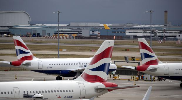 British Airways planes at Terminal Five at Heathrow Airport (PA)