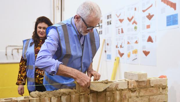Labour leader Jeremy Corbyn tries his hand at bricklaying during a visit to the West Nottinghamshire College Construction Centre in Ashfield (Joe Giddens/PA)