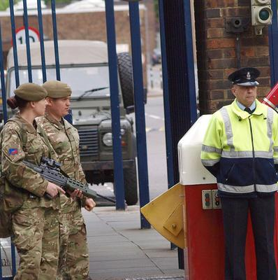 Armed servicemen outside The Royal Artillery Barracks in Woolwich (PA)