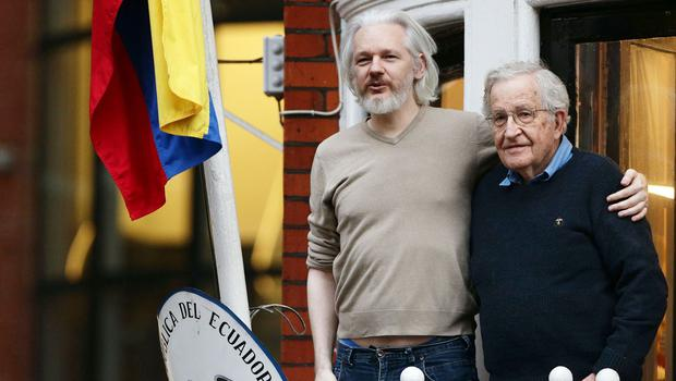 Julian Assange, pictured here with Noam Chomsky, is confined to the Ecuadorian Embassy
