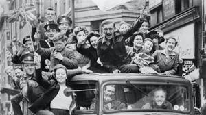 A truck of revellers passing through the Strand in London following the announcement of Germany's surrender (Imperial War Museum/PA)