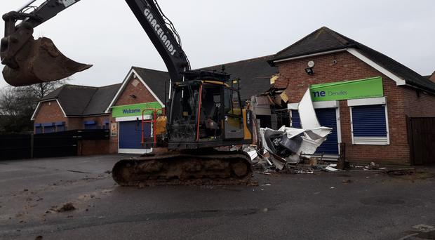 A stolen digger used to remove ATM causing damage to the Co-op store in Snowberry Crescent, Havant (Hampshire Constabulary/PA)