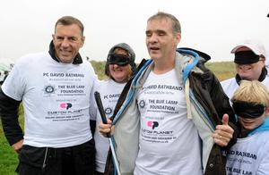 Pc Rathband, joined by businessman Duncan Bannatyne, raised funds for his Blue Lamp Foundation (Owen Humphreys/PA)