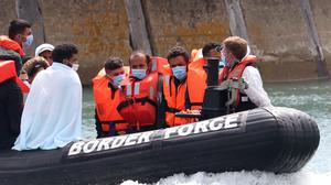 A Border Force vessel brings a group of men thought to be migrants into Dover, Kent (Gareth Fuller/PA)