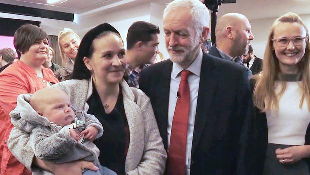 Jeremy Corbyn meets a young fan during a visit to Lancaster University (Phil Barnett/PA)