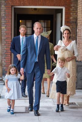 Princess Charlotte and Prince George hold the hands of their father, the Duke of Cambridge, as they arrive at the Chapel Royal, St James's Palace, London for the christening of their brother, Prince Louis, who is being carried by their mother, the Duchess of Cambridge (Dominic Lipinski/PA)