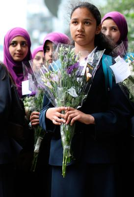 Pupils from Eden Girls School in Waltham Forest take part in last night's vigil for the victims in Potters Field Park
