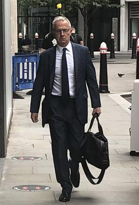Former Barclays boss Stephen Jones arrives at the High Court in London on Thursday to give evidence in a £1.6 battle involving the bank and businesswoman Amanda Staveley (Brian Farmer/PA)