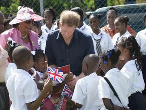 Harry meeting children during his visit to Grenada (Paul Edwards/The Sun/PA)