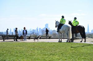 Police officers speaking to people on Primrose Hill in London on April 14 (Kirsty O'Connor/PA)
